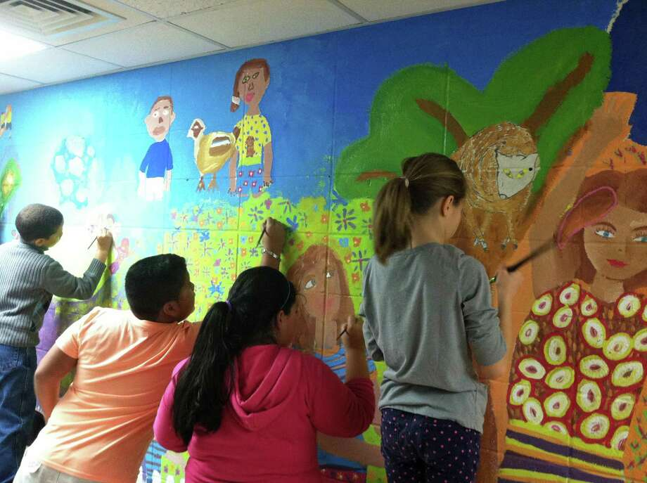 Fifth-grade students from Silvermine Elementary School in Norwalk work on a mural as part of Art Partners, a program of the Silvermine Arts Center. Photo: Contributed Photo / New Canaan News Contributed