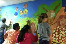 Fifth-grade students from Silvermine Elementary School in Norwalk work on a mural as part of Art Partners, a program of the Silvermine Arts Center.