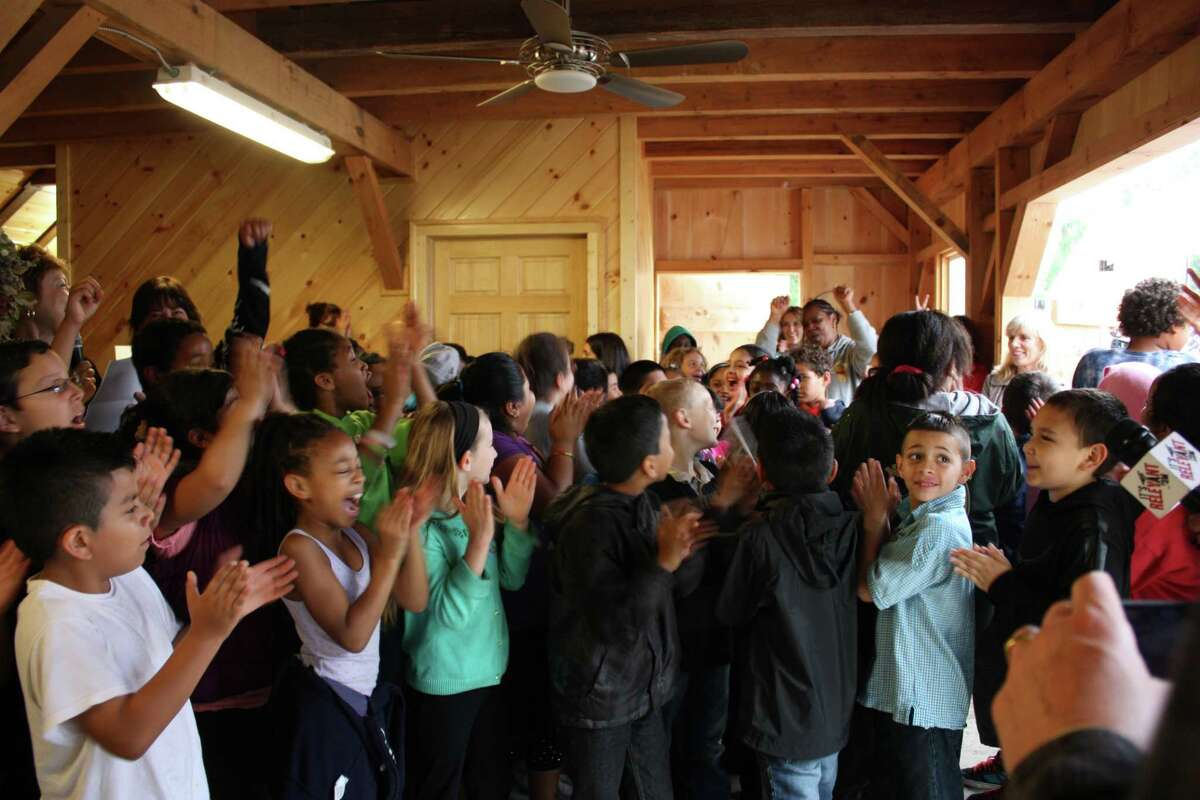 Third-graders from Brookside Elementary School in Norwalk are enthusiastic at the installation ceremony for nine public sculptures created by Art Partners in collaboration with Norwalk Parks and Recreation for Fodor Farm. Art Partners is a program of the Silvermine Arts Center in New Canaan.