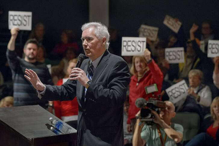 """Congressman Tom McClintock, R-Calif., fields questions from an audience at the Tower Theatre in Roseville, Calif., Saturday, Feb. 4, 2017. McClintock on Saturday faced the rowdy crowd at the packed town hall meeting in Northern California, and had to be escorted by police as protesters followed him shouting """"Shame on you!"""" (Randall Benton/The Sacramento Bee via AP)"""