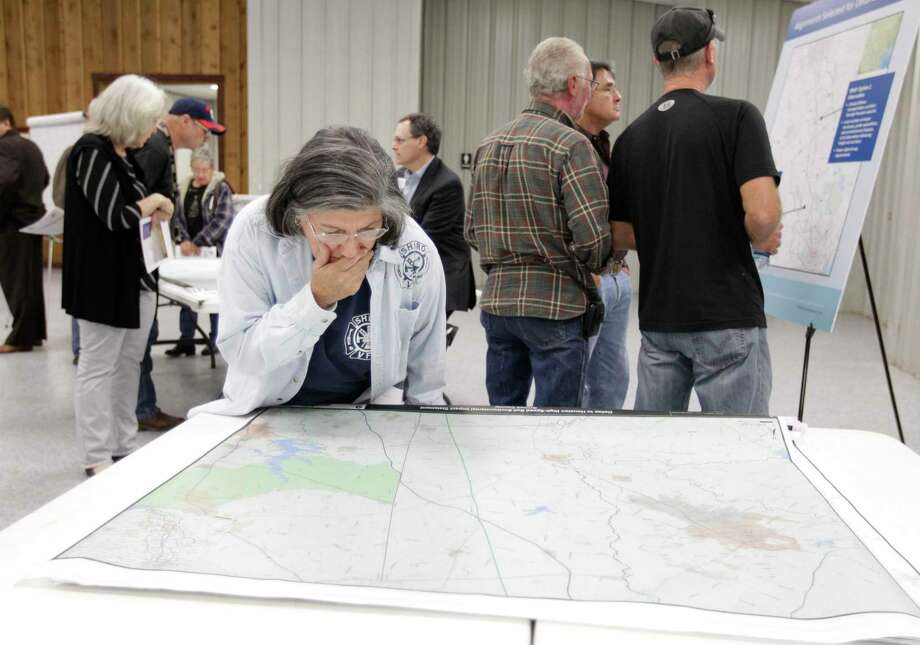 Bertha Sustaita of Shiro looks at a map while attending a public meeting on Dec. 4, 2014, in Navasota at the Grimes County Expo Center about the proposed high-speed rail project from Dallas to Houston. Photo: Melissa Phillip, Staff / © 2014  Houston Chronicle
