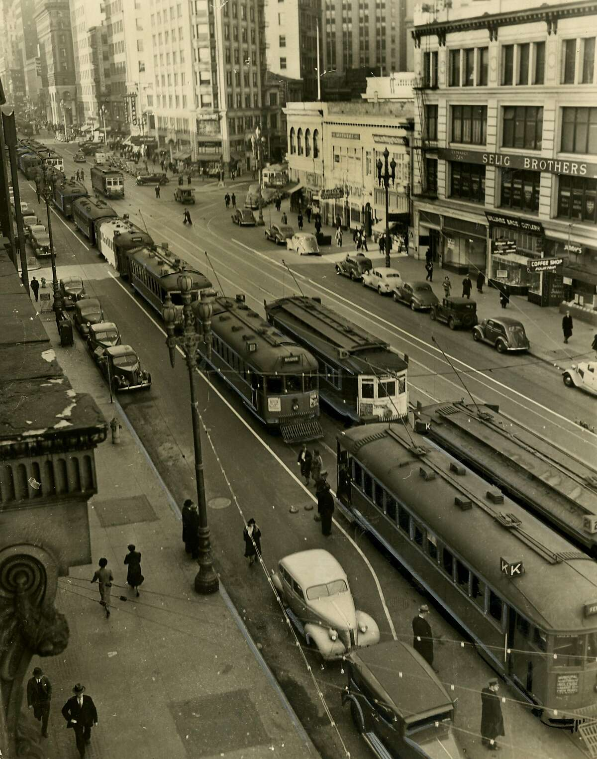 """From the back of the photo: """"When the flood of commuters arrived at the Bay Bridge rail terminal yesterday morning, the San Francisco street car service bogged down. Street cars were forced to inch along First, Fremont and Market Streets. Officials declare the traffic problems will be solved in a few days."""" January 17, 1939."""