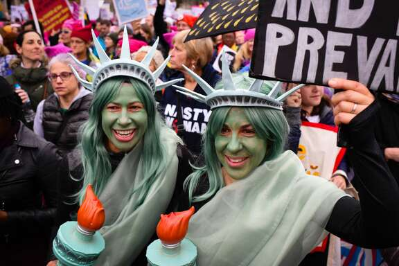 Sisters, Kristina Buchwald, left of Idaho Springs, Colorado and Laura Ast, of San Francisco, CA were dressed as the statue of liberty. Thousands of people marched in Washington, DC on  Saturday January 21, 2016 for the Women's March on Washington.