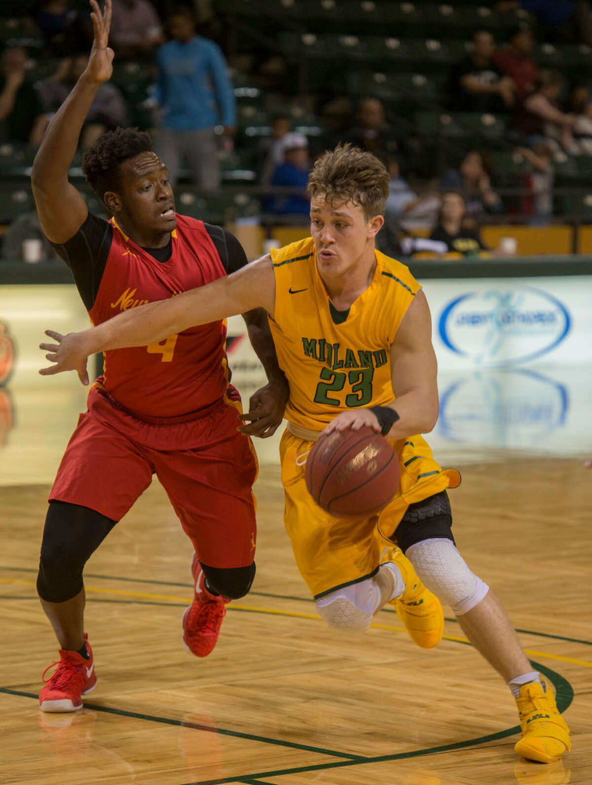 Midland College's Grant Weatherford drives the lane as New Mexico Junior College's DeVante Waldon defends Monday 01-23-17 at the Chaparral Center. Tim Fischer/Reporter-Telegram