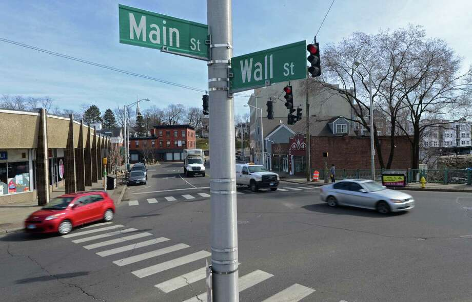 The intersection of Main and Wall Streets Tuesday, February 21, 2017, in Norwalk, Conn. The Norwalk Redevelopment Agency has asked for $500,000 in the city's forthcoming 2017-18 capital budget to improve the intersection of East Wall and Main streets in central Norwalk. The project, which has the strong backing of Wall Street redeveloper M.F. DiScala & Co., would realign curbs, establish safe travel lanes, and install historic lighting fixtures and pedestrian-safe crosswalks at one of the city's most dangerous intersections. Photo: Erik Trautmann / Hearst Connecticut Media / Norwalk Hour