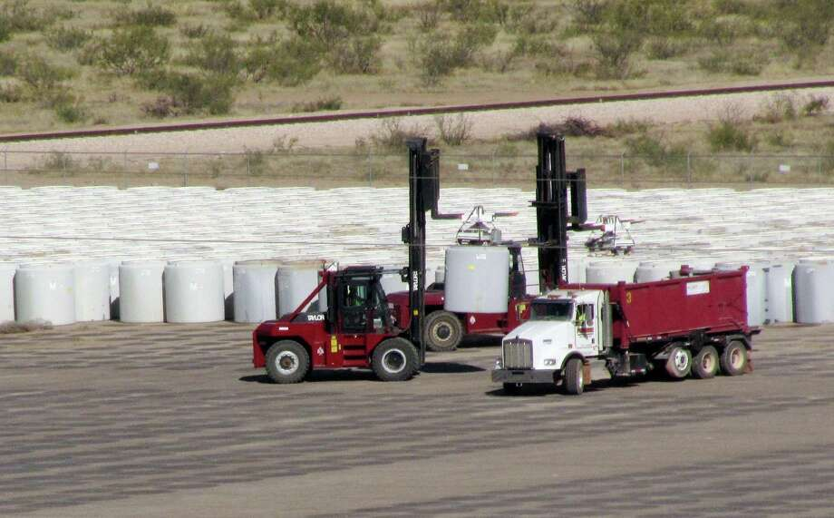 In this Oct. 27, 2009, photo are some of the 3,776 canisters of uranium byproduct waste being buried at Waste Control Specialists near Andrews, Texas. The site could become the holding place for more dangerous nuclear waste. Photo: Betsy Blaney /AP / AP2010