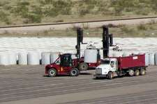 In this Oct. 27, 2009, photo are some of the 3,776 canisters of uranium byproduct waste being buried at Waste Control Specialists near Andrews, Texas. The site could become the holding place for more dangerous nuclear waste.