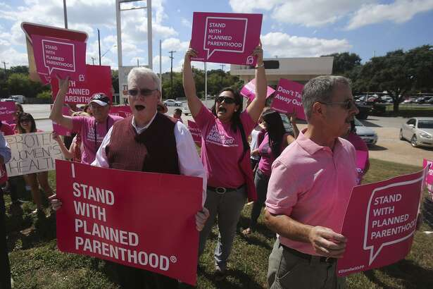 Supporters for Planned Parenthood shout chants at passing traffic Tuesday September 29, 2015 at the corner of Loop 410 and Nacogdoches road. Congress votes soon on whether or not to defund the agency.
