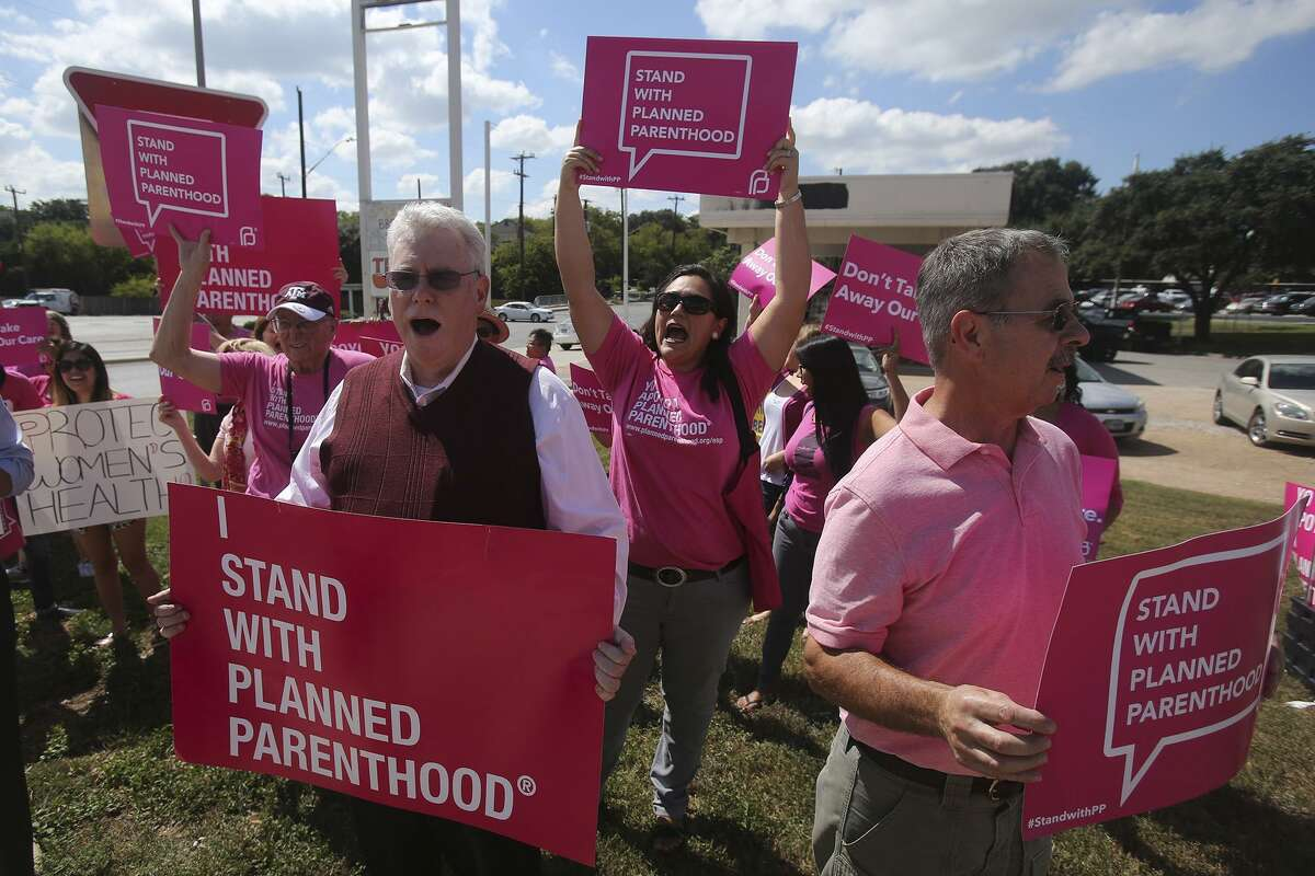 Supporters for Planned Parenthood shout chants at passing traffic Tuesday September 29, 2015 at the corner of Loop 410 and Nacogdoches road. Congress is again considering defunding Planned Parenthood. The nation could learn of the consequences by studying what happened when Texas did so.