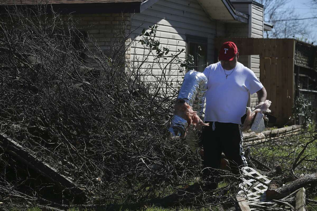 Clean up efforts continue Tuesday February 21, 2017 on Linda street after tornados swept through north central San Antonio late Sunday night.
