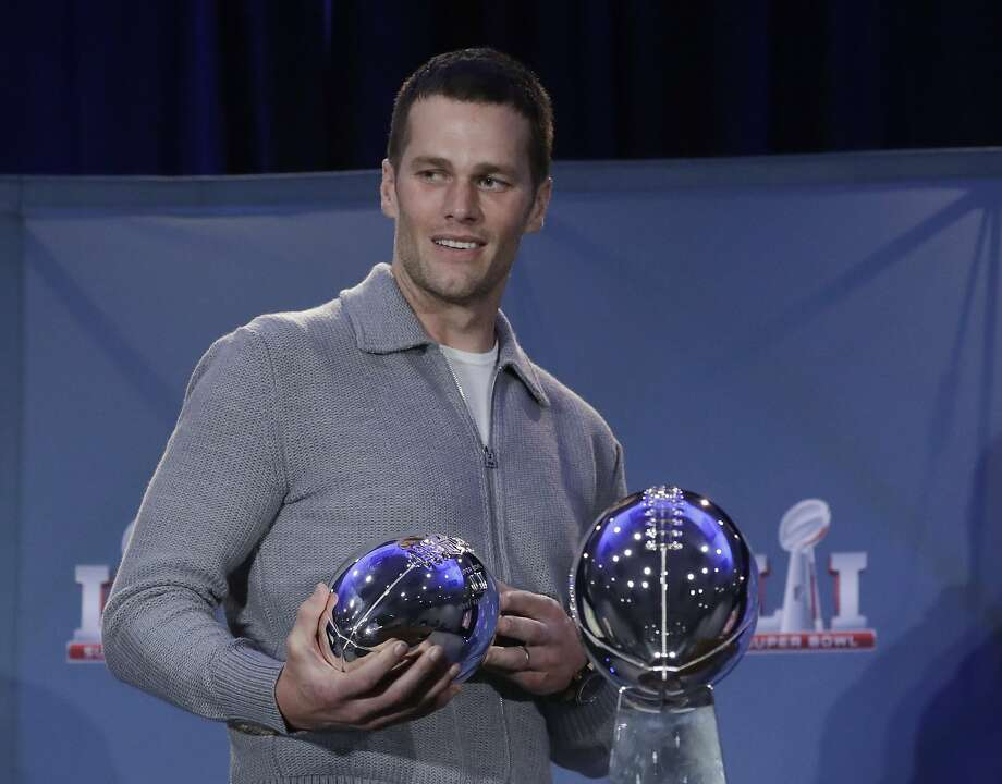FILE - In this Feb. 6, 2017, file photo, New England Patriots quarterback Tom Brady walks off with his MVP trophy during a news conference after the NFL Super Bowl 51 football game in Houston. Zoo Atlanta announced Monday, Feb. 13, 2017, that it named a baby cockroach after Brady. (AP Photo/Morry Gash, File) Photo: Morry Gash, Associated Press