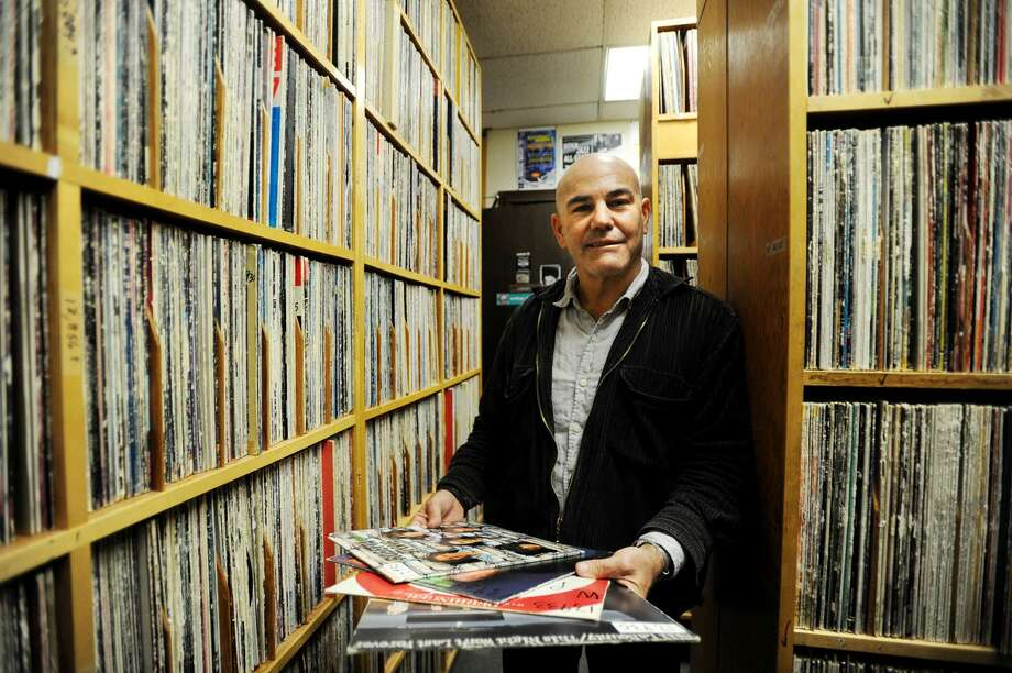 General Manager Steven di Costanzo stands among the sixty-five thousand vinyl records at WPKN radio at 244 University Avenue on the University of Bridgeport campus in Bridgeport, Conn. on Tuesday, February 21, 2017. The station is currently raising funds to replace its analog transmitter, for which replacement tubes are no longer manufactured, with a modern version. Photo: Brian A. Pounds / Hearst Connecticut Media / Connecticut Post