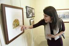 Sacred Heart alumna Genevieve Irwin shows her monotype painting of a Siberian tiger cub at the exhibition of her work displayed at Sacred Heart Greenwich in Greenwich, Conn. Tuesday, Feb. 21, 2017. Irwin is working on a collection of monotype paintings for a children's book about Siberian tigers while completing her MFA in Illustration at the School of Visual Arts in New York.