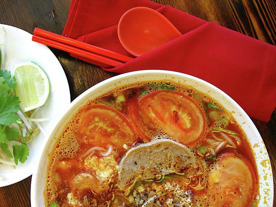 A tomato-laced noodle soup called bún riêu, seasoned with crumbled cakes of egg, dried shrimp and crab paste, from Berni Vietnamese Restaurant. Photo: Mike Sutter /San Antonio Express-News