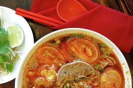 A tomato-laced noodle soup called bún riêu, seasoned with crumbled cakes of egg, dried shrimp and crab paste, from Berni Vietnamese Restaurant.