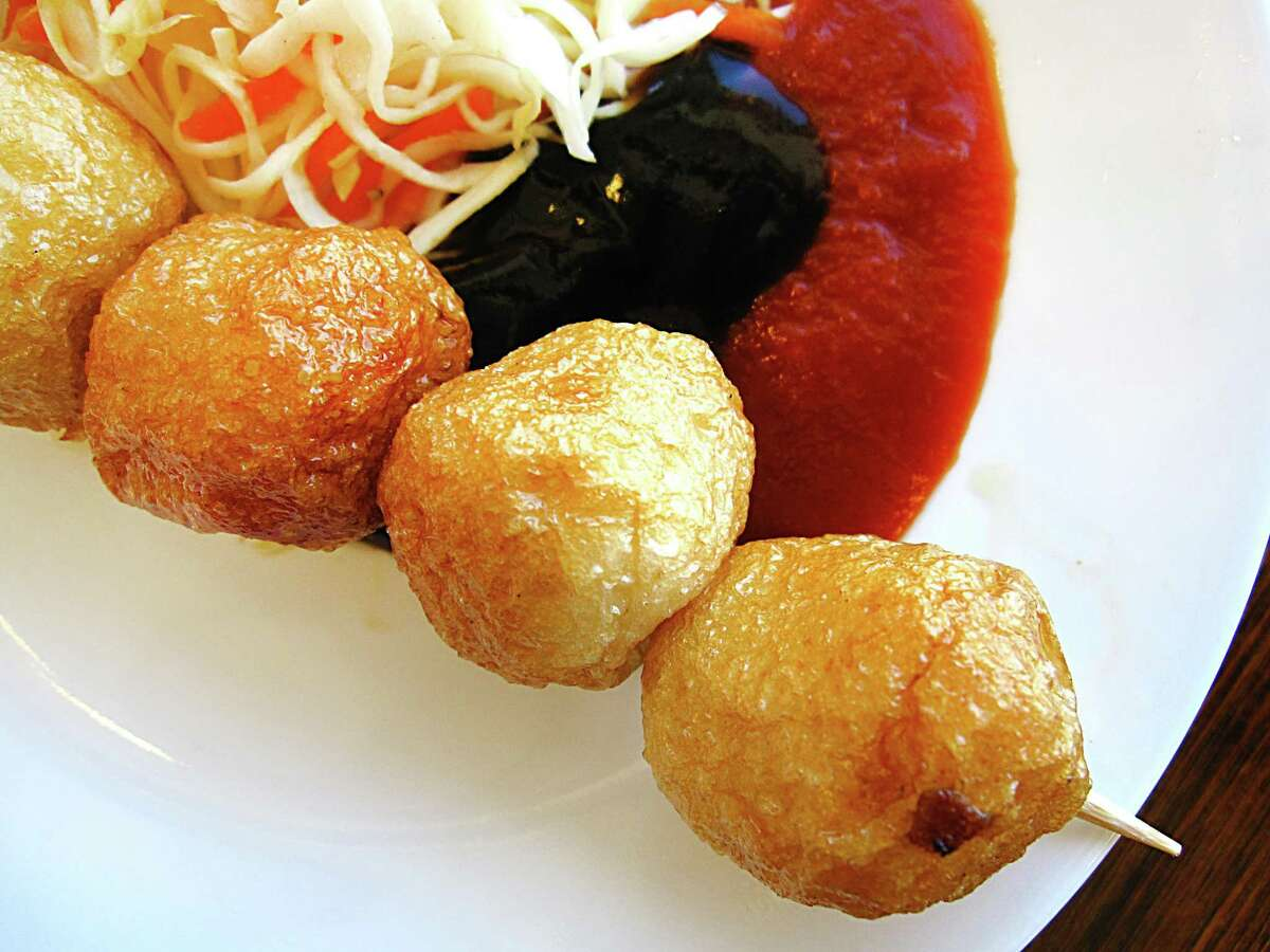 An appetizer of fried fish balls with cole slaw, hoisin and sriracha from Berni Vietnamese Restaurant.