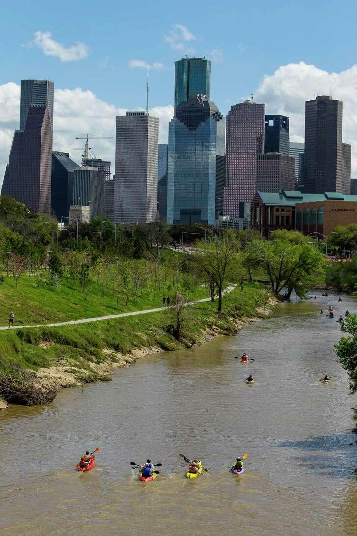 Paddlers pass through Buffalo Bayou Park during the 15-mile Buffalo Bayou Partnership Regatta.