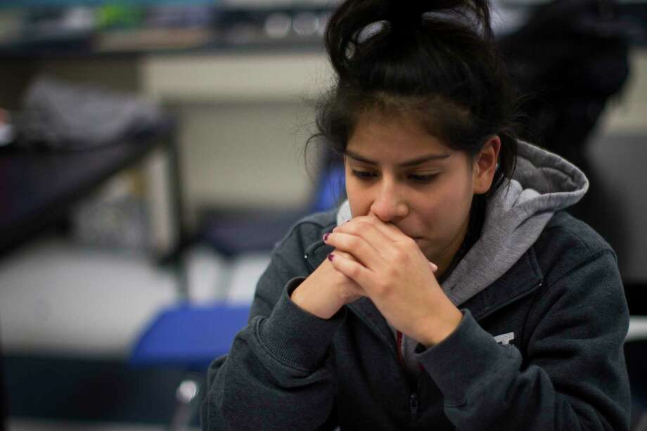 """Monica Alfaro, a YesPrep Gulfton student gets emotional as she shares with other """"dreamer"""" club members the pain she feels to think that Deferred Action for Childhood Arrivals would get repealed by President Donald Trump. Thursday, Jan. 26, 2017, in Houston. ( Marie D. De Jesus / Houston Chronicle ) Photo: Marie D. De Jeséºs, Staff / © 2017 Houston Chronicle"""