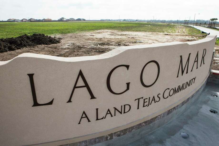 The Lago Mar subdivision sign in shown on Monday, Feb. 13, 2017, in Texas City. Texas City is developing a subdivision, of up to 7,000 homes, on what is reportedly the largest single parcel still available for residential development on I-45 between Dallas and Galveston. ( Brett Coomer / Houston Chronicle ) Photo: Brett Coomer, Staff / © 2017 Houston Chronicle