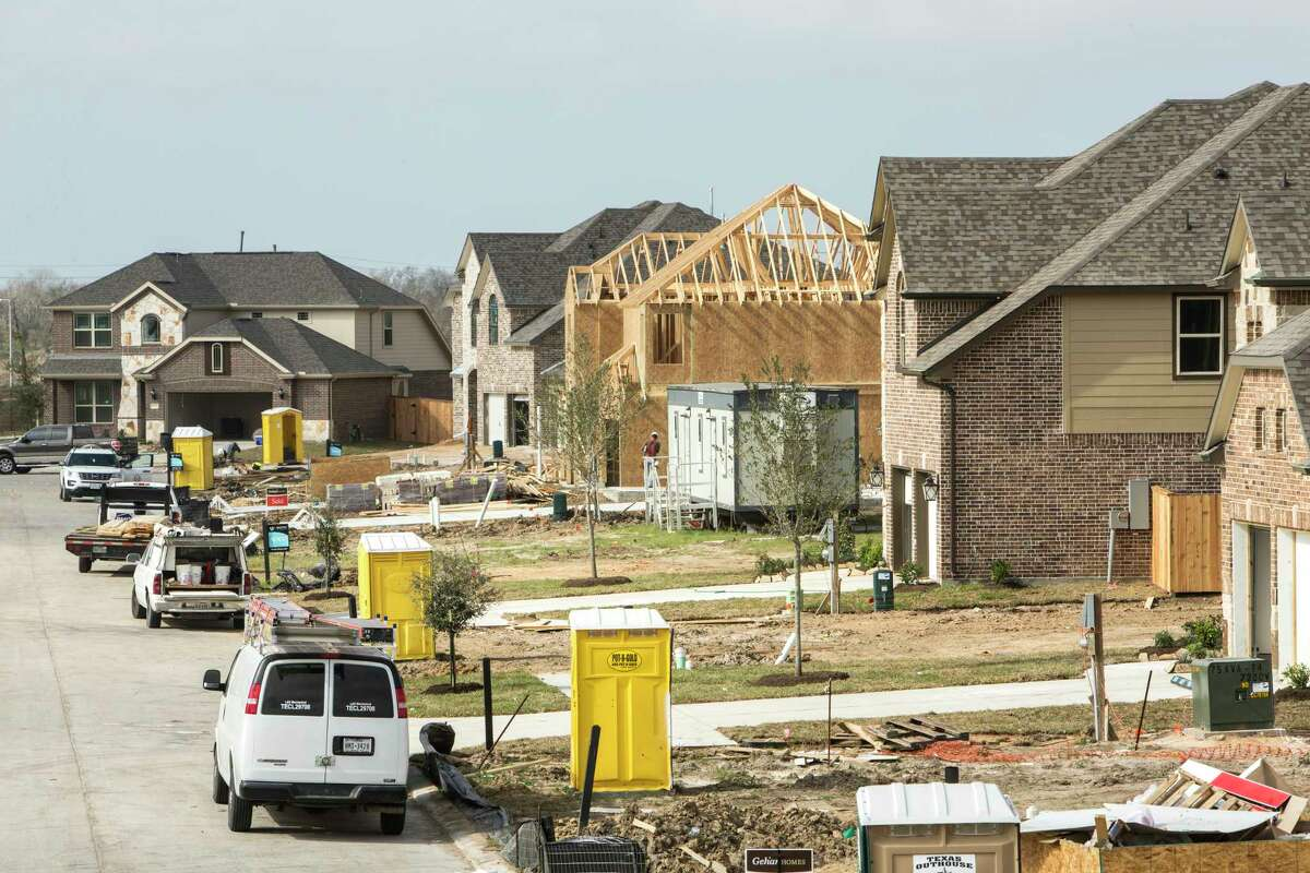 Construction workers work on building homes in the Lago Mar subdivision Monday, Feb. 13, 2017, in Texas City. Texas City is developing a subdivision, of up to 7,000 homes, on what is reportedly the largest single parcel still available for residential development on I-45 between Dallas and Galveston. ( Brett Coomer / Houston Chronicle )