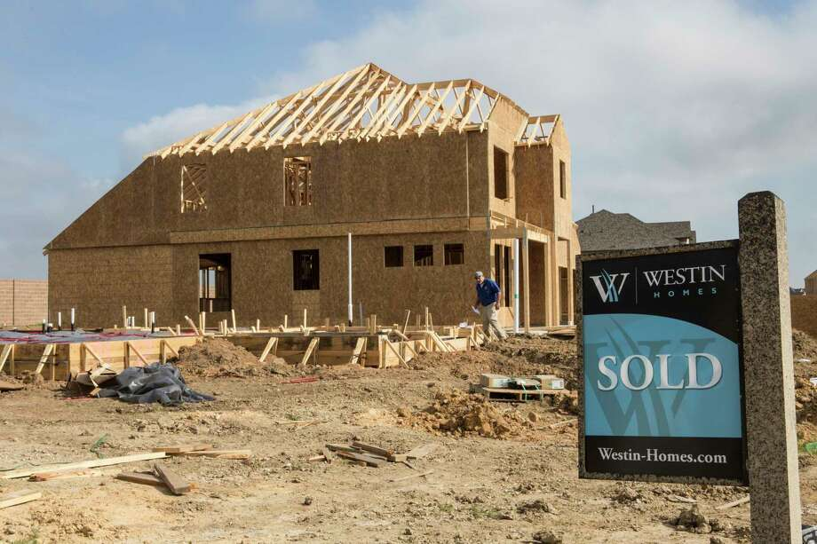 Construction workers work on building homes in the Lago Mar subdivision Monday, Feb. 13, 2017, in Texas City. Texas City is developing a subdivision, of up to 7,000 homes, on what is reportedly the largest single parcel still available for residential development on I-45 between Dallas and Galveston. ( Brett Coomer / Houston Chronicle ) Photo: Brett Coomer, Staff / © 2017 Houston Chronicle
