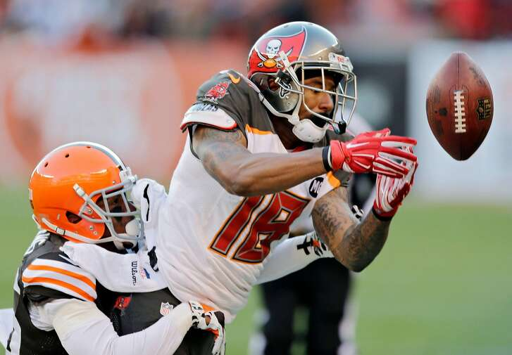 Tampa Bay Buccaneers wide receiver Louis Murphy, right, can't hang on to a pass under pressure from Cleveland Browns defensive back K'Waun Williams in the fourth quarter of an NFL football game Sunday, Nov. 2, 2014, in Cleveland. (AP Photo/Tony Dejak)