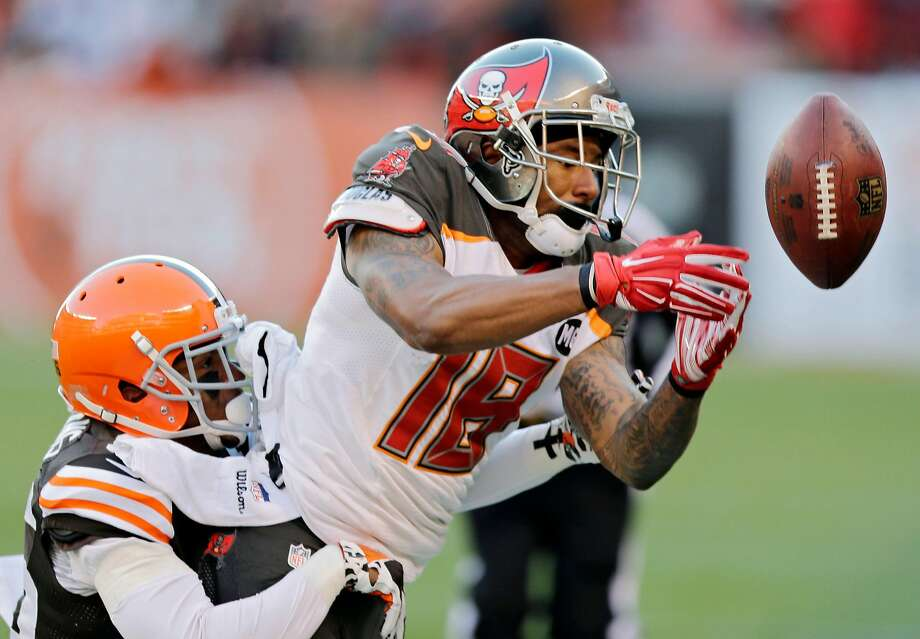 Tampa Bay Buccaneers wide receiver Louis Murphy, right, can't hang on to a pass under pressure from Cleveland Browns defensive back K'Waun Williams in the fourth quarter of an NFL football game Sunday, Nov. 2, 2014, in Cleveland. (AP Photo/Tony Dejak) Photo: Tony Dejak, Associated Press