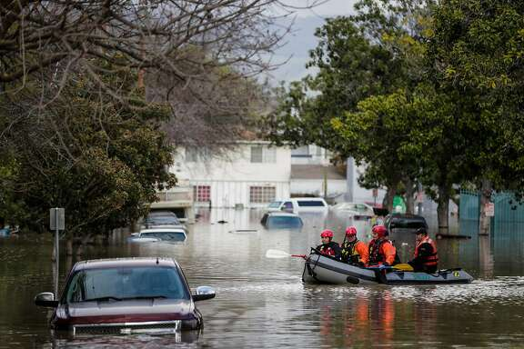 Rescue teams went out in boats to make sure people weren't left behind after many were forced to evacuate by boat due to severe flooding in San Jose, California, on Tuesday, Feb. 21, 2017.
