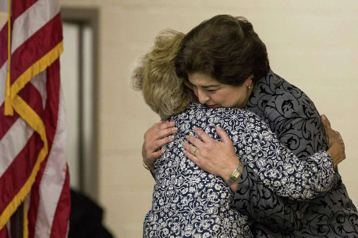 Lucy Eller embraces Olga M. Hernandez before an SAISD school board meeting at David G. Burnet Center in San Antonio, Texas on February 21, 2017. Ray Whitehouse / for the San Antonio Express-News