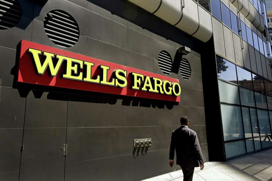 Wells Fargo said credit card applications dropped 55 percent in February from a year earlier while retail customers opened 43 percent fewer checking accounts. Wells Fargo has been releasing monthly data on the retail unit's performance following the Sept. 8 revelation that employees may have opened as many as 2 million deposit and credit card accounts over a half decade without customers' permission. Photo: Associated Press /File Photo / Copyright 2017 The Associated Press. All rights reserved.