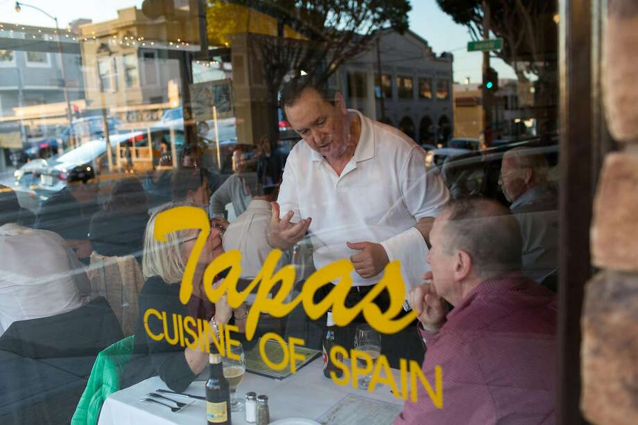 Diners at Zarzuela on Russian Hill, which opened in 1994, hear about its huge menu of more than 40 savory courses. Photo: Randi Lynn Beach, Special To The Chronicle