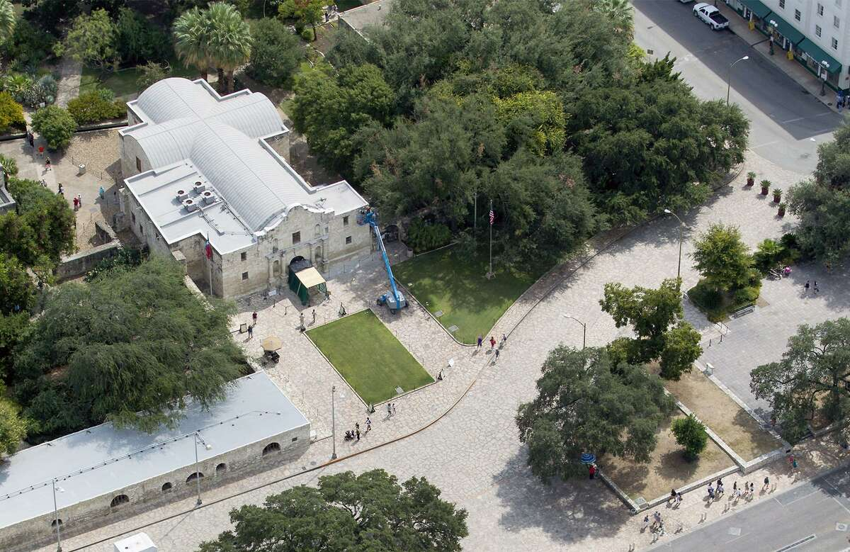Alamo Plaza, with the Alamo at the top of the frame, is seen in a Thursday Oct. 8, 2015 aerial photo. Three buildings the Texas General Land Office agreed to buy can be seen at the bottom of the frame.