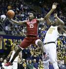 Stanford guard Marcus Allen, shown trying to score despite the defense of Cal's Kingsley Okoroh last month, has averaged 12.3 points in the Cardinal's past nine games.