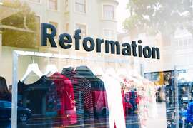 The sleek 2,000-square-foot Reformation store at 914 Valencia St. seems to find that sweet spot between high-end  retail and fast fashion. Instead of cramming the sales floor with inventory, founder Yael Aflalo applied the streamlined Apple retail approach: individual samples of the  brands best-sellers hang on well-spaced white hangers made from recycled  materials; all other stock remains hidden on the back end.