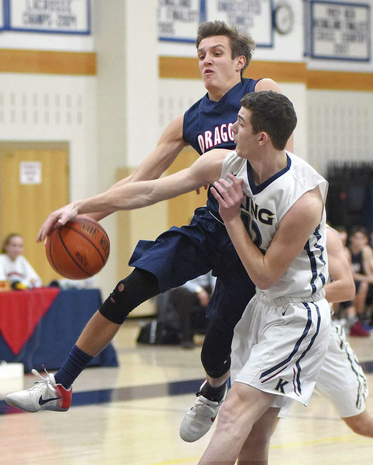 GFA's Henry Holzinger, left, is stripped of the ball by King's Renn Lints in Tuesday's game.