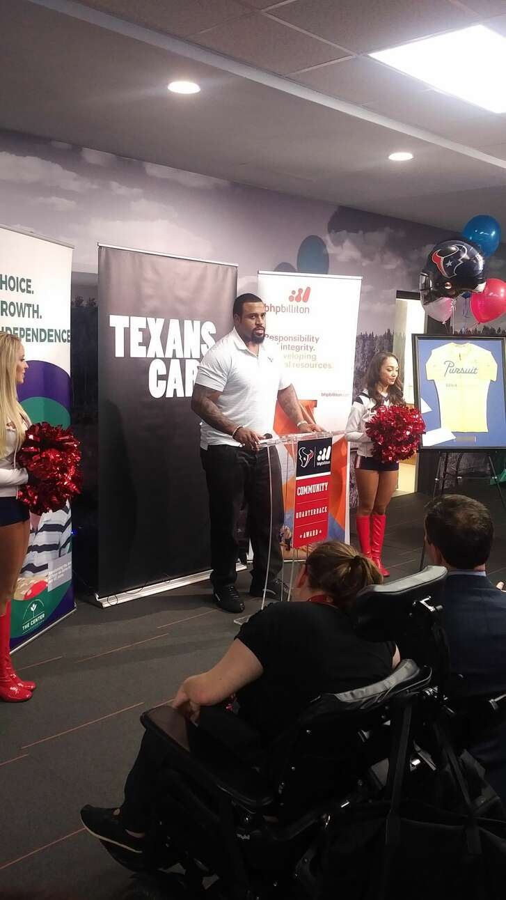 Texans' Duane Brown at The Center in Houston, where he presented Texans' Community Quarterback award grand prize to Center board member David Baldwin, for his dedication on behalf of organization that assists individuals with disabilities.