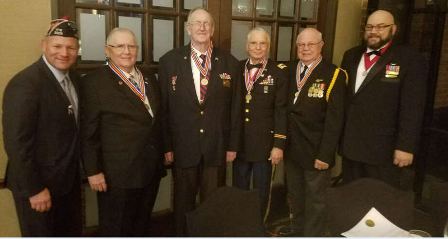 The Commander of Katy Veterans of Foreign Wars Post 9182 recently honored outstanding volunteers at the third annual Katy Military Dining Out. From left are Fort Bend County Sheriff Troy Nehls, (four Awardees of the Commander's Medal for Excellence in Volunteerism), Katy Mayor Fabol Hughes, Post Adjutant Ron Byrne Sr., Post Honor Guard Capt. Ron Catchings, Jim Scoggins and Post Commander Frank Torres. Photo: Katy VFW