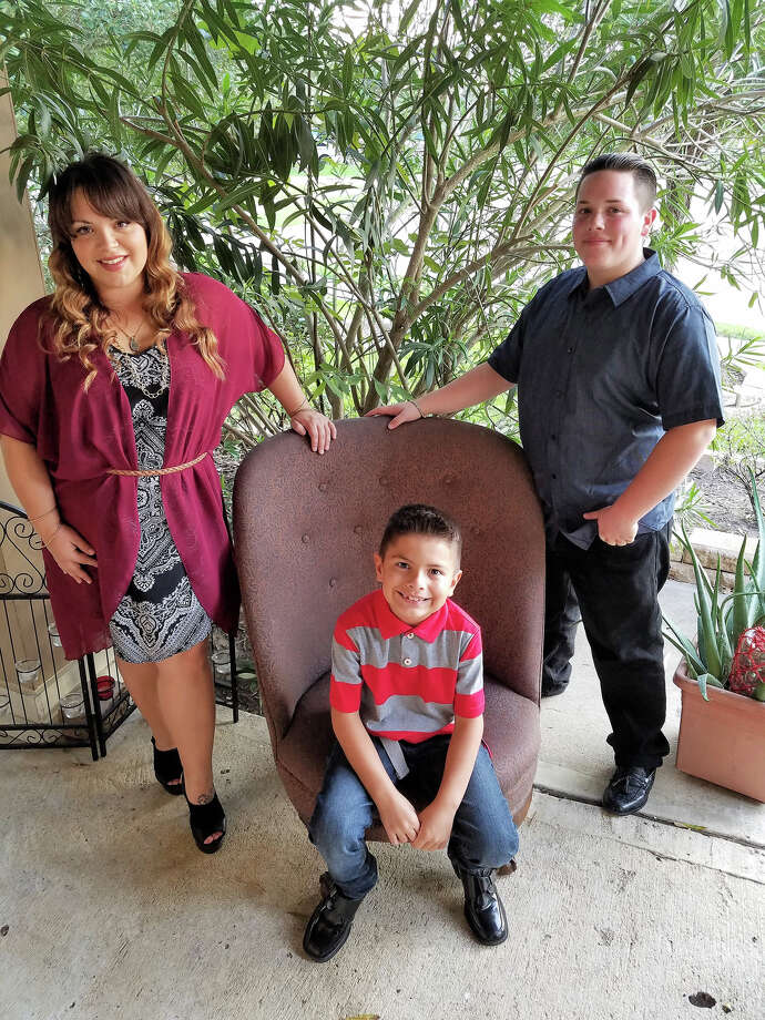 Adrianna Adams said her two sons, Cristiano Adams, 14, and Luciano Salazar, 9, have benefited from a Rotary Club of Katy donation to the Neuhaus Education Center. Photo: Neuhaus Education Center