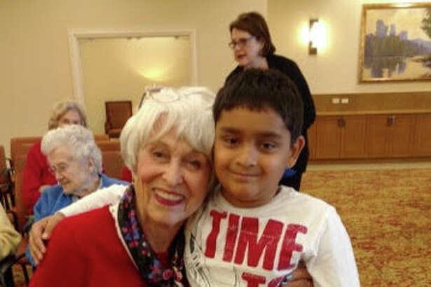 Tarun Vesireddy hugs Elaine Adams as part of a group of nearly 70 second-graders from The Honor Roll School in Sugar Land who recently visited a senior citizen community, Brazos Towers at Bayou Manor in Houston, to sing songs and deliver handmade cards. The visit, which was part of the school's yearly service project, served as an opportunity for the students to learn the importance of giving back to local community members.