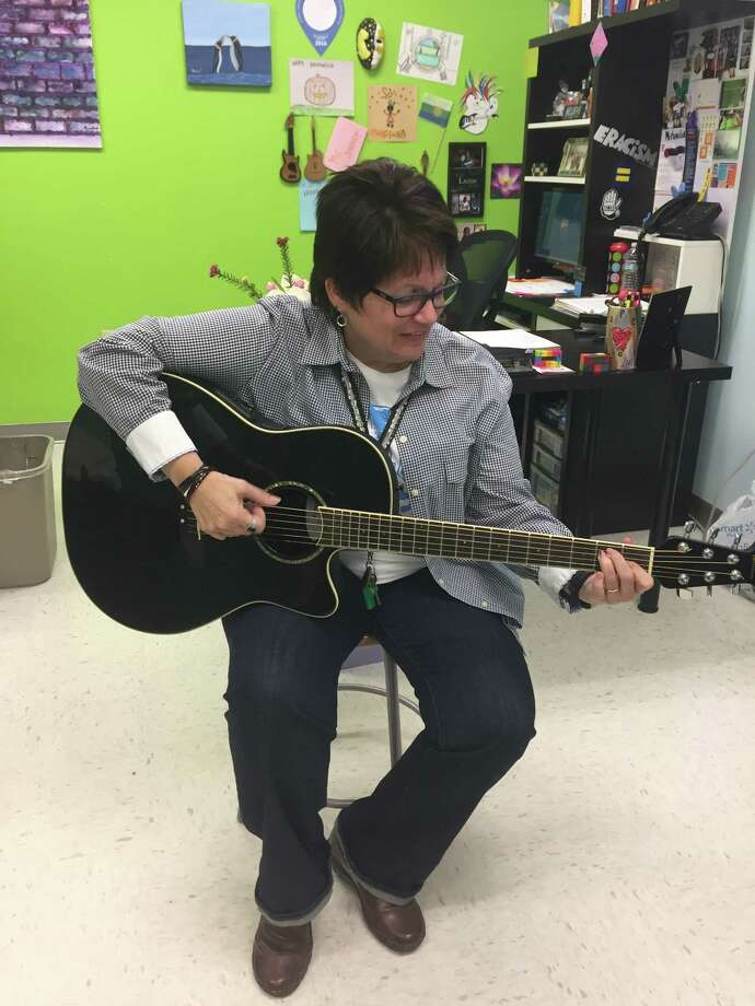Lourdes Jimenez is the Communities in Schools Project Manager for Spring Forest Middle School. She helps provides services to students. Jimenez enjoys playing the guitar, which she plays with several students after school. Photo: Rebecca Hazen