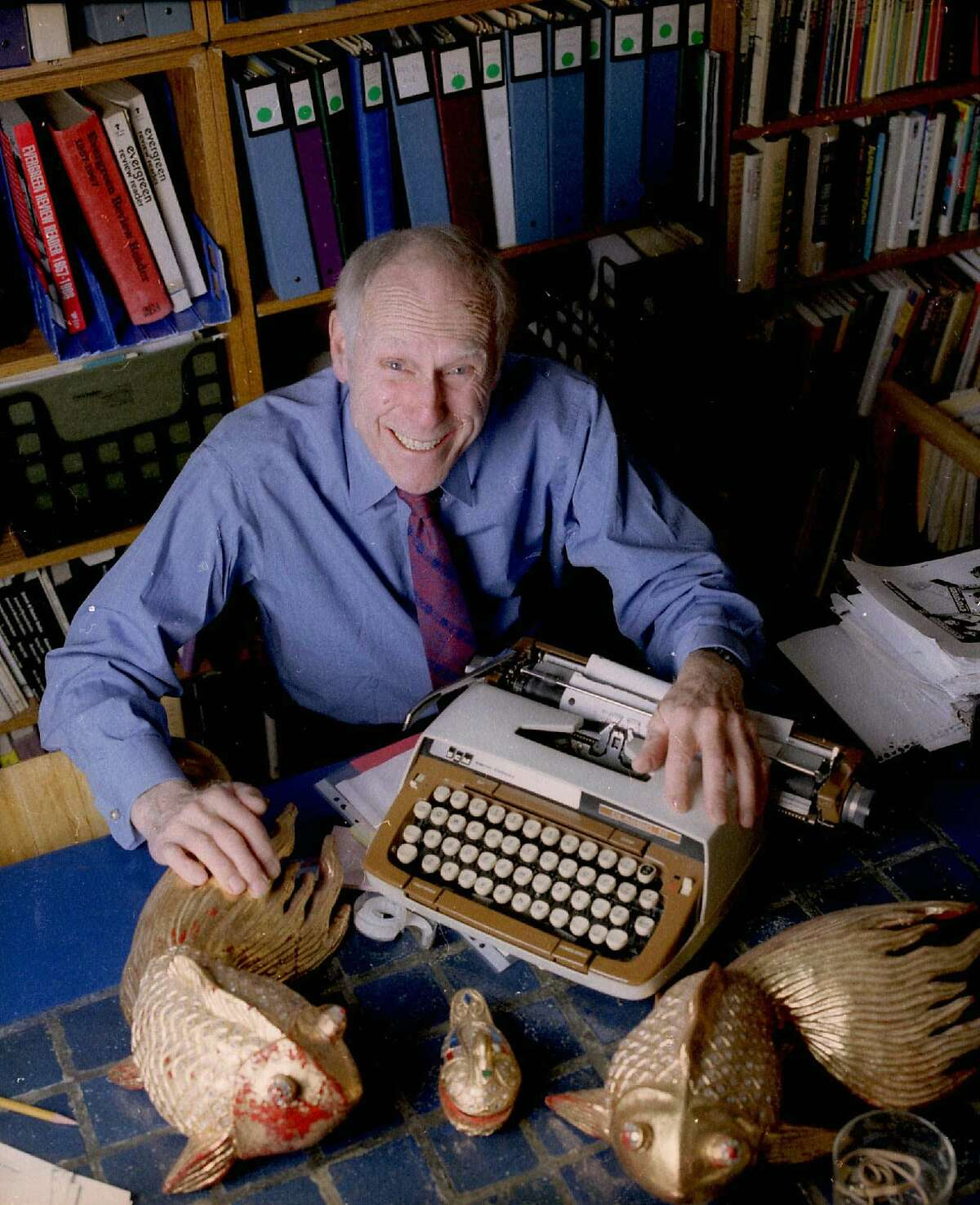 **FILE** In this Jan. 5, 1998 file photo, publisher Barney Rosset, 75, poses with some of his favorite things in his New York loft. Rosset, the publisher and First Amendment defender whose battles on behalf of Henry Miller's