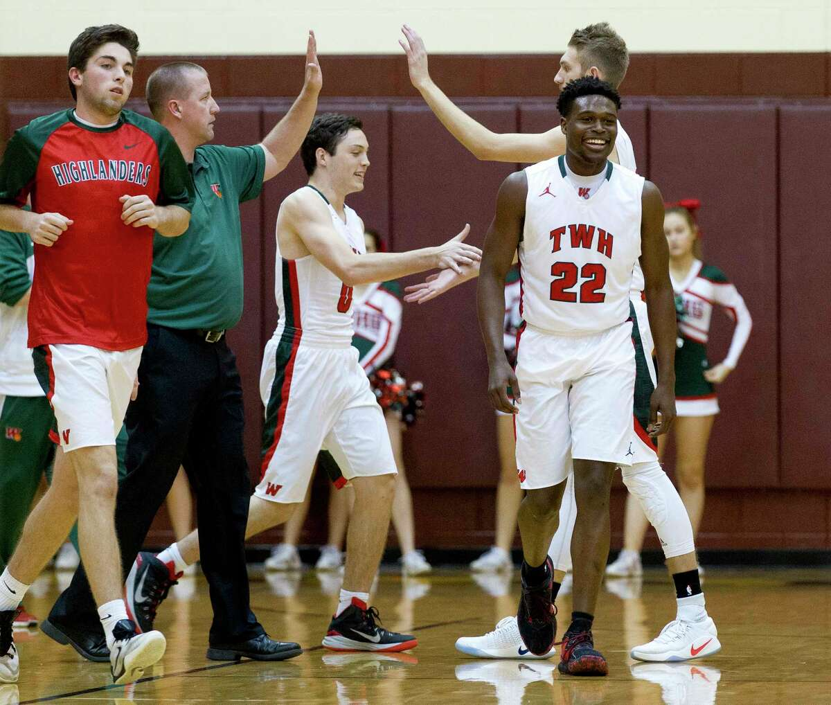 The Woodlands guard Romello Wilbert (22) smiles after a shot by guard Sammy Williams (30) that forced a timeout by Mesquite Horn during the first quarter of a Region II-6A high school basketball bi-district playoff game at Johnson Activities Center Tuesday, Feb. 21, 2017, in Fairfield. The Woodlands defeated Mesquite Horn 64-42.