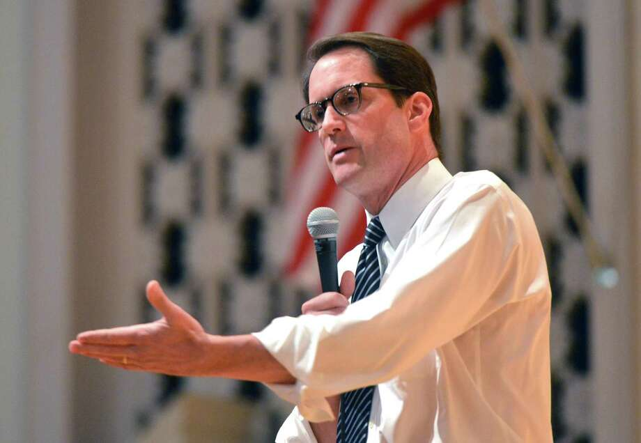 Congressman Jim Himes, D-Conn., answers questions from the audience during a town hall meeting at the Norwalk Concert Hall auditorium on Tuesday. Photo: Alex Von Kleydorff / Hearst Connecticut Media / Connecticut Post