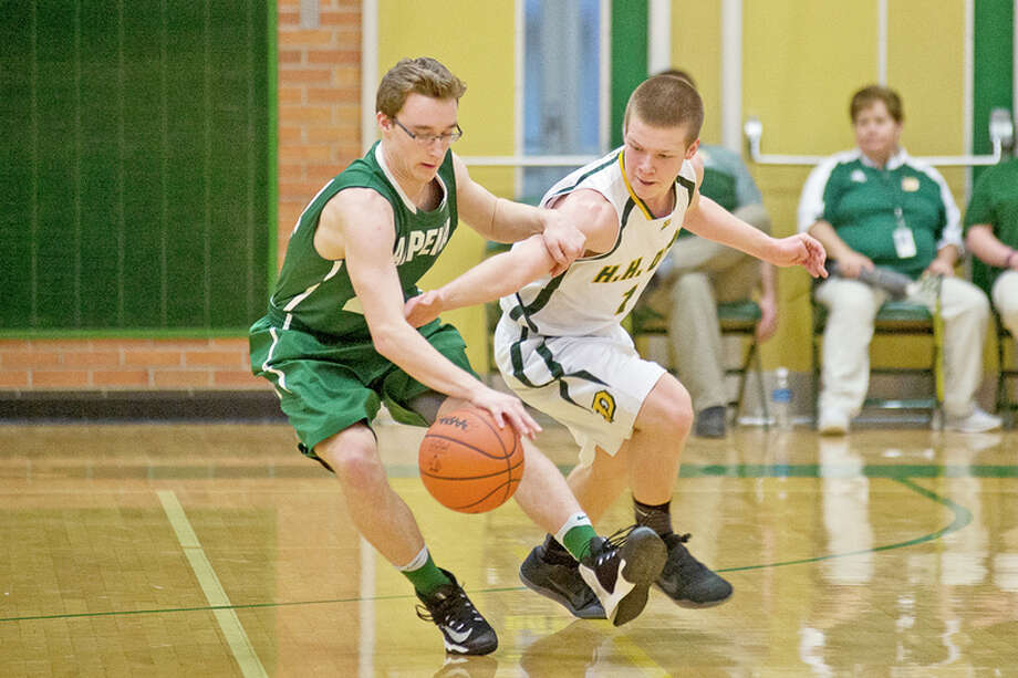 ERIN KIRKLAND | ekirkland@mdn.net  Dow's Trevor Davis, right, fights Alpena's Isaac Jore for possession of the ball on Tuesday at H. H. Dow High School.