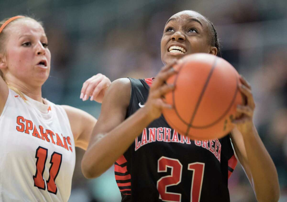 Feb. 21: Langham Creek 50, Seven Lakes 46 Dyani Robinson (21) of the Langham Creek Lobos goes for a layup against the Seven Lakes Spartans in Girls High School Basketball Playoffs on Tuesday, February 21, 2017 at the Merrell Center in Katy, Texas.