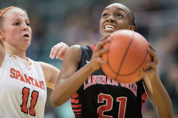 Dyani Robinson (21) of the Langham Creek Lobos goes for a layup against the Seven Lakes Spartans in Girls High School Basketball Playoffs on Tuesday, February 21, 2017 at the Merrell Center in Katy, Texas.