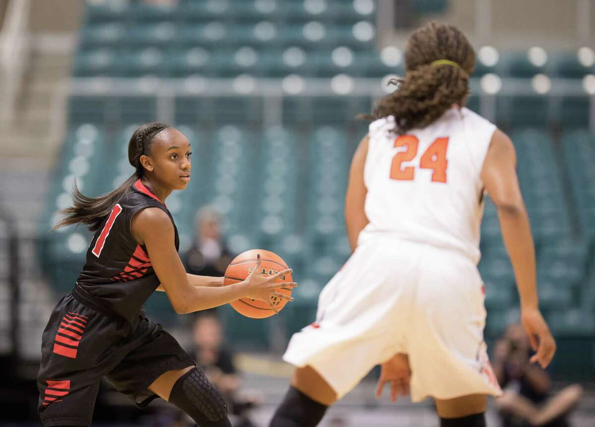 Dyani Robinson (21) of the Langham Creek Lobos looks to pass the ball against the Seven Lakes Spartans in Girls High School Basketball Playoffs on Tuesday, February 21, 2017 at the Merrell Center in Katy, Texas.