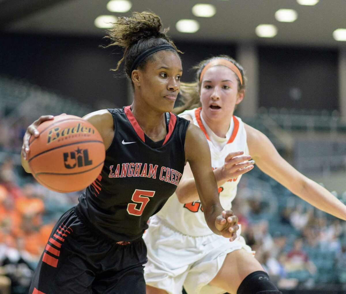 Dezeree White (5) of the Langham Creek Lobos drives to the basket against the Seven Lakes Spartans in Girls High School Basketball Playoffs on Tuesday, February 21, 2017 at the Merrell Center in Katy, Texas.