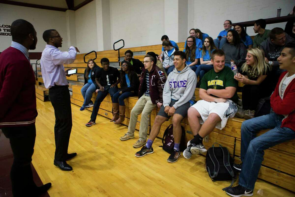 Prairie View A&M University students Keylan Ceasar, left, 22, and Carrington Johnson, center, 20, teach Waller High School students about personal finances, including how to file taxes, at the school gymnasium on Tuesday in Waller. wwwThe classes are aimed at teaching students lessons about finances including how to file taxes, how to balance a check book, how to build a budget and how to start saving for retirement.