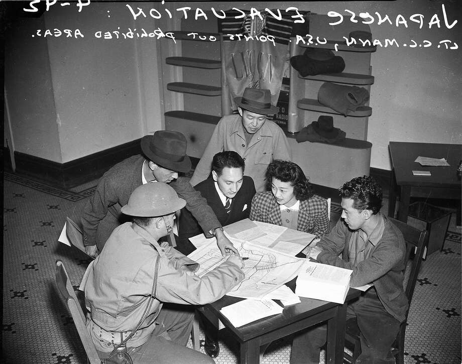 April 6, 1942: A U.S. military officer explains point out prohibited areas to a Japanese family from San Francisco. Photo: Chronicle File Photo, The Chronicle